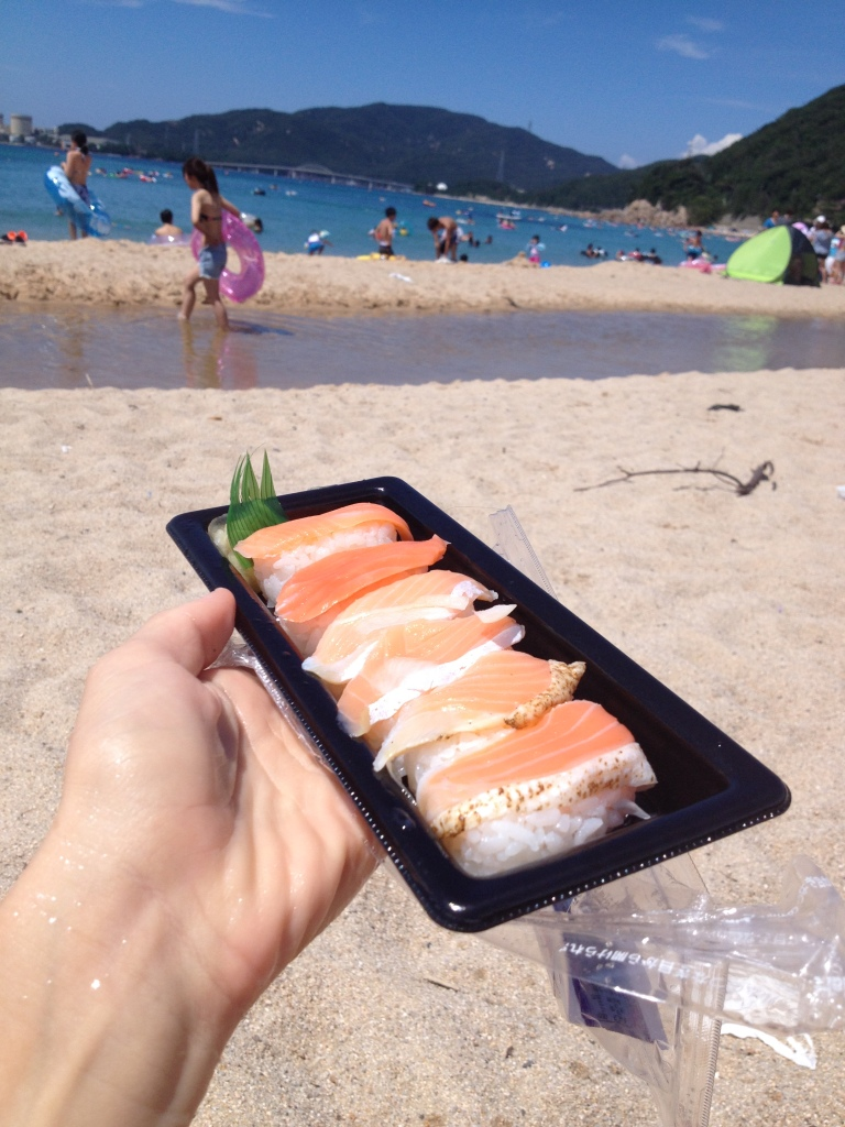 Sushi at the beach! Bought it at the daiso (convenience store) for 400 yen (less than 4 dollars).