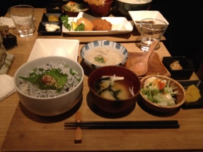 One of my meals in Tokyo. Miso soup, pickled veggies, and rice mixed with tiny fish called shirasu. You crack the egg in it and make a pudding-like mixture.