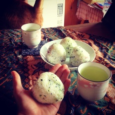 I learned how to make triangular onigiri (rice balls!) This has seaweed inside