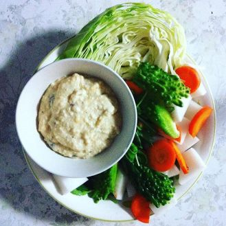 Tofu white bean dip with cabbage, carrot, daikon, and goya.